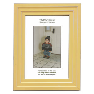 Handcrafted sunny yellow colored photo frame with linear white accents