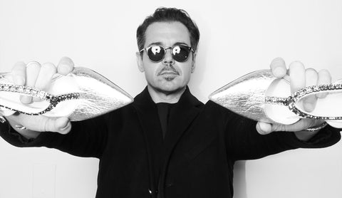 Image of Founder Mirco Scoccia holding a Pair of Brigitte heels