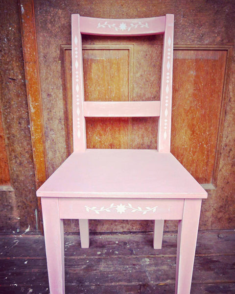 Modern chair update painted in white and pink with beautiful folk art white stencil design