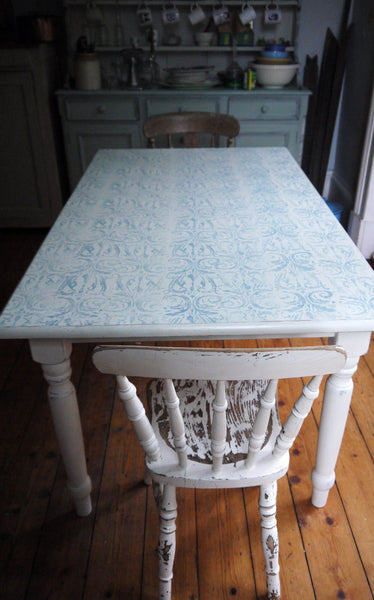 Classic farmhouse dining table updated in Annabell Duke chalk paint in blue and cream with gorgeous decorative design on the top