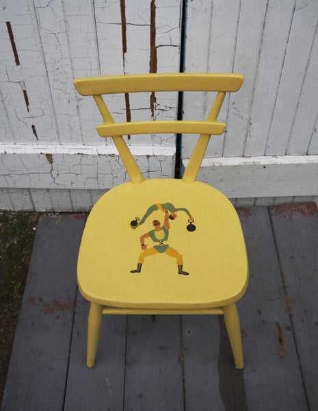 Vintage Ercol childrens chair in yellow with retro strongman design by Emily Rose Vintage