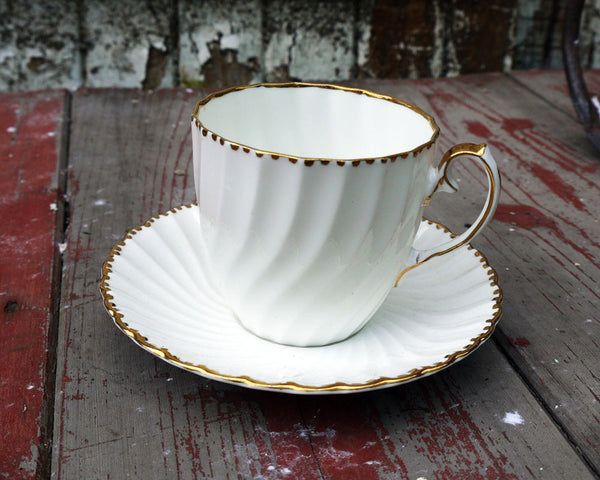 Fluted white and gold vintage teacup and saucer