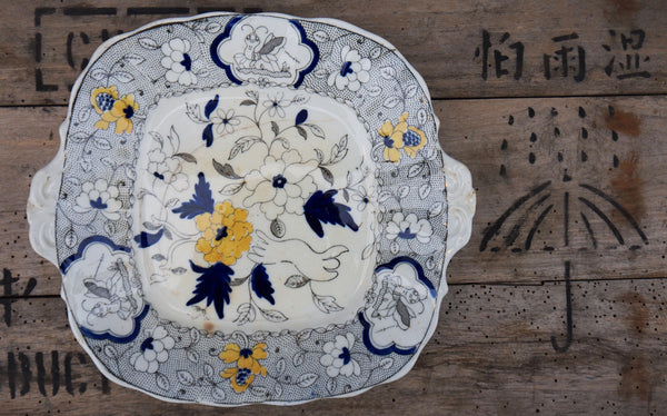Gorgeous vintage blue and yellow cake plate. Some age related marks, crazing and hairline crack but the plate is still solid and beautiful!