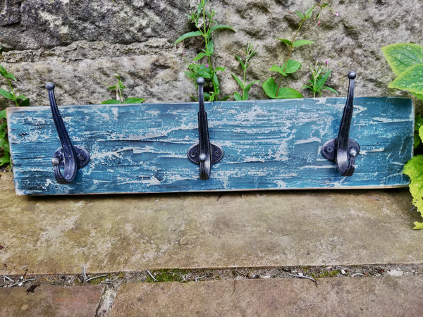 Hand made coat rack with 3 hooks.