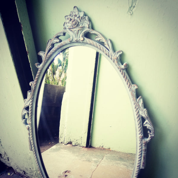 Beautiful painted vintage ornate mirror in soft blue
