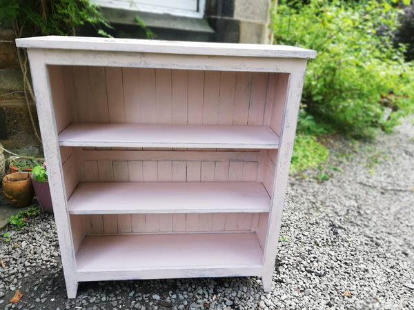 Boho pink painted bookcase with rose theme