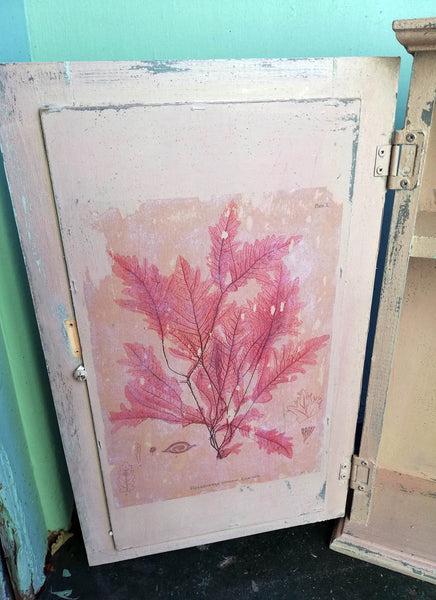 Vintage bathroom cabinet painted in soft pink