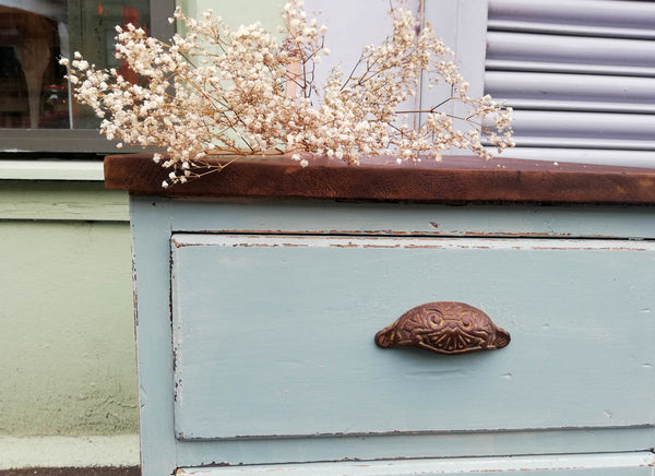 Rustic industrial set of drawers painted in a soft duck egg blue