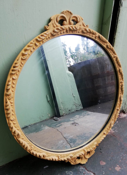 Beautiful painted vintage ornate mirror in soft mustard yellow