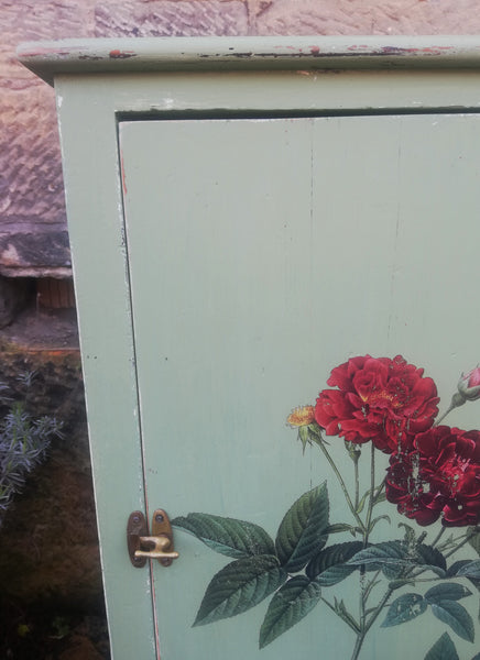 Cabinet painted in layers of Miss Mustard Seed Milk Paint with vintage rose design
