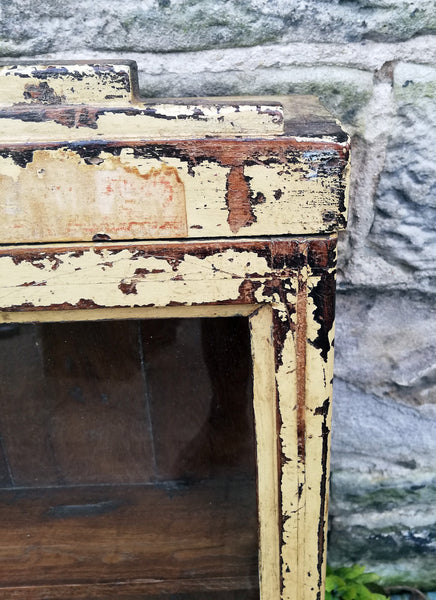 Beautiful antique teak painted glass fronted wall cabinet with original golden yellow chippy paint