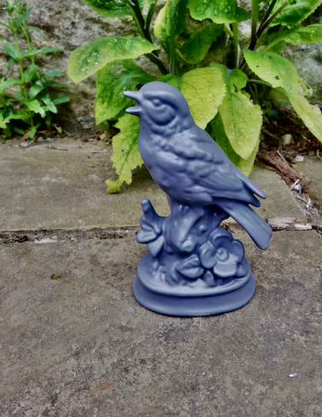 Little porcelain bird in slate grey