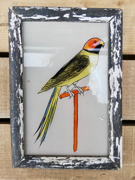 Vintage glass painting of a parrot in a beautiful original frame