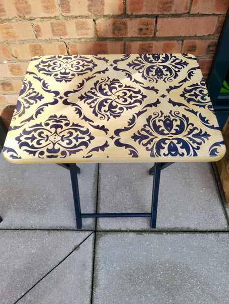 Stencilled folding side table with damask design in navy.