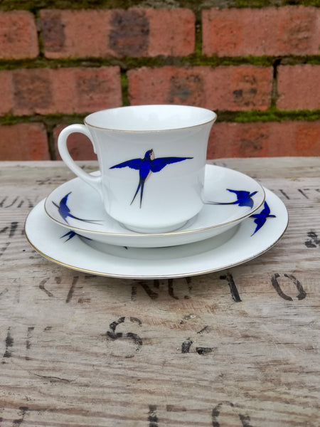 Vintage white swallow design teacup and side plate