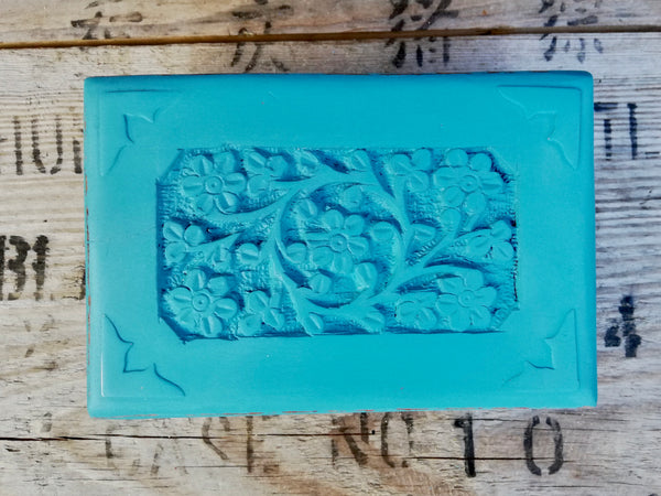 Carved wooden box painted in a beautiful bright blue