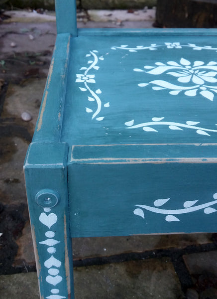 Little Children's chair painted in a deep green with folk art stencil design in white