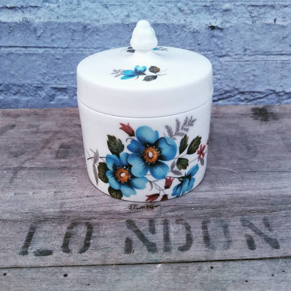 Little blue and white floral lidded pot.