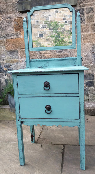 Little carved vintage dressing table painted in chippy milk paint in robin's egg blue.