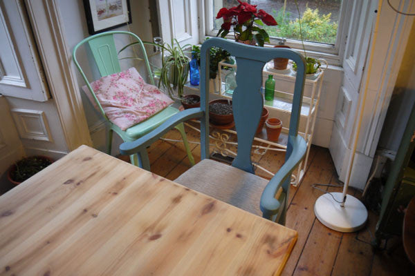 refurbished dining table and 6 upholstered dining chairs