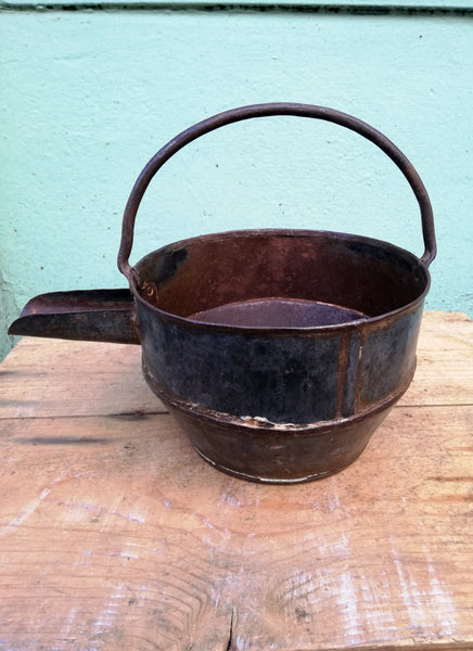 Restored antique iron curd pots.