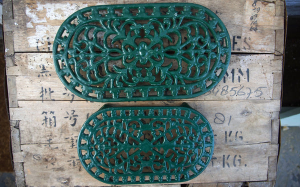 Set of 2 ornate vintage green enamel trivet pot rests