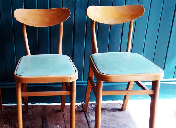 Set of 2 vintage mid century children's chairs with original mint green vinyl seats