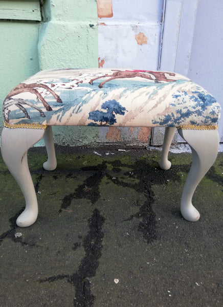 Stunning refurbished footstool in Linwood hunting fabric.