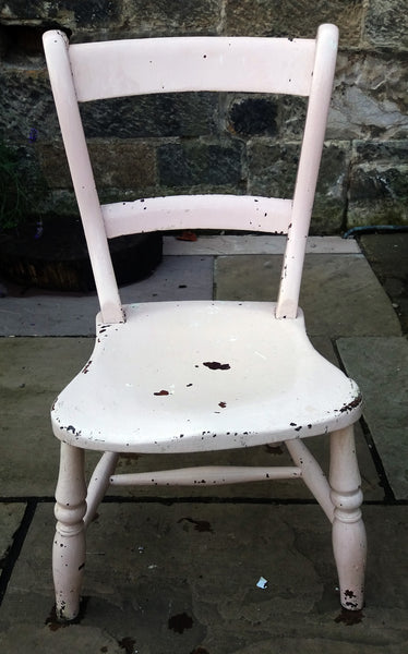 Super cute vintage children's chair in its original pink chippy paintwork