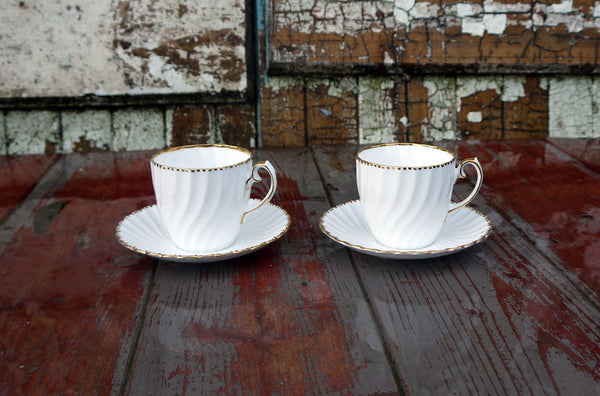 Tea for Two  fluted white and gold vintage teacups and saucers