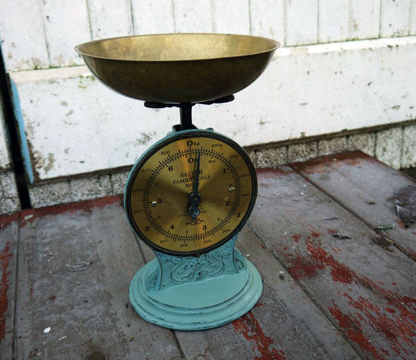 Vintage brass tone weighing scales with the base painted in Miss Mustard Seed Milk Paint and sealed with wax