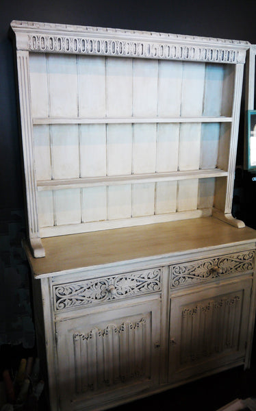 Vintage carved oak kitchen dresser painted in a soft cream and distressed and antique glazed for a vintage finish