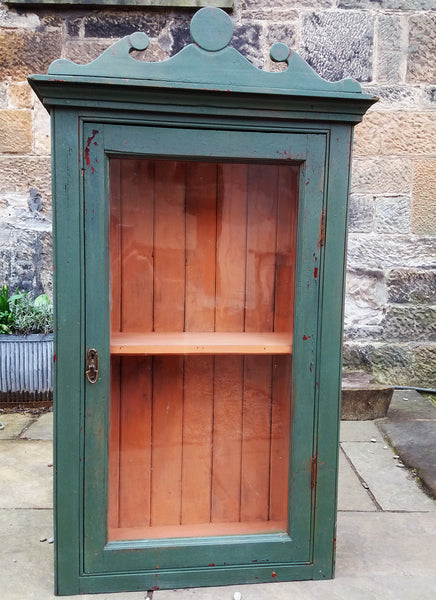 Vintage glass fronted cabinet in an antique chippy milk paint finish
