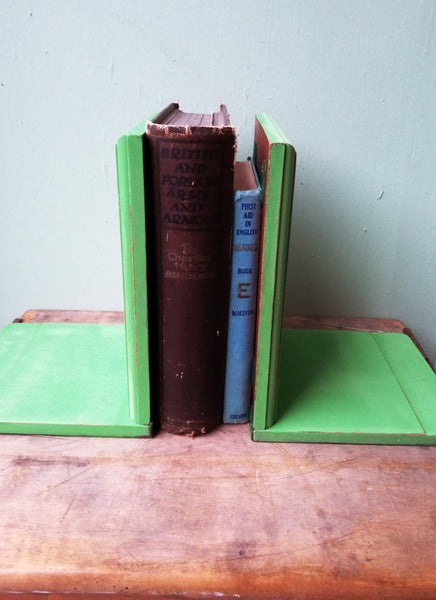 RESERVED Vintage pair of bookends painted in a vibrant green with parakeet deign