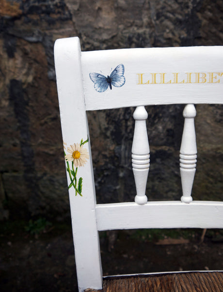 Vintage personalised children's rush seat chair with bees and butterfly design