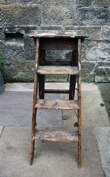 Vintage wooden paint splattered step ladder