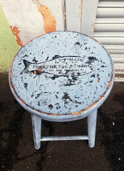 Vintage wooden stool with retro fish design on the seat, painted using  saltwash