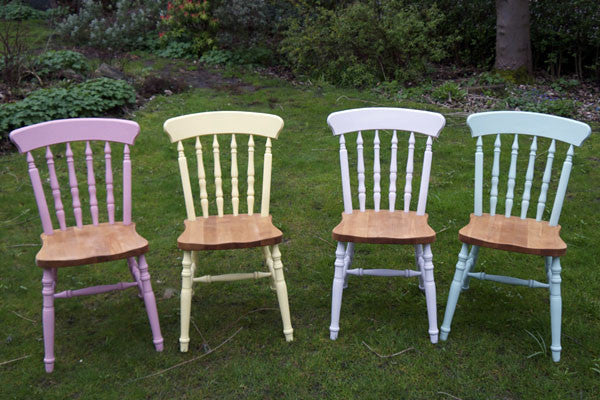 dining chairs in mismatch colours and stripped wooden seats