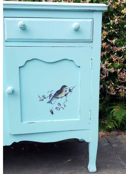 hand painted sideboard with bird design