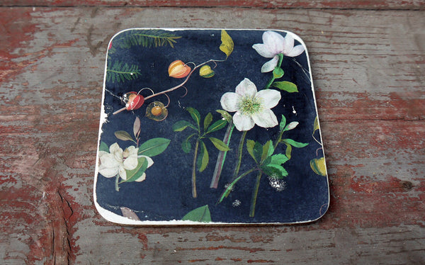 Set of six vintage paper coasters in dark grey and floral design on white.