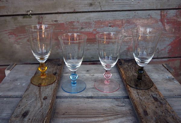 beautiful set of 4 glasses with coloured stems. Perfect condition.