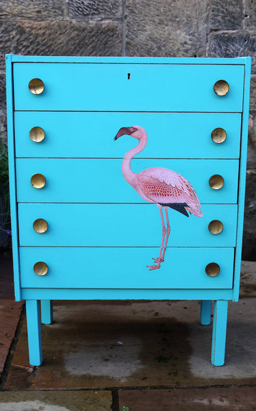 Vintage mid century children's chest of drawers painted in azure blue with pink flamingo design