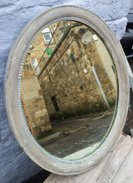 Vintage oval mirror frame just finished in chippy layers of miss mustard seed milk paint.