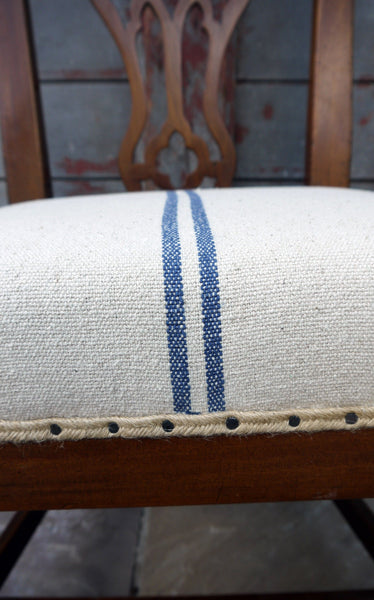 Vintage occasional bedroom chair in grain sack linen upholstery.