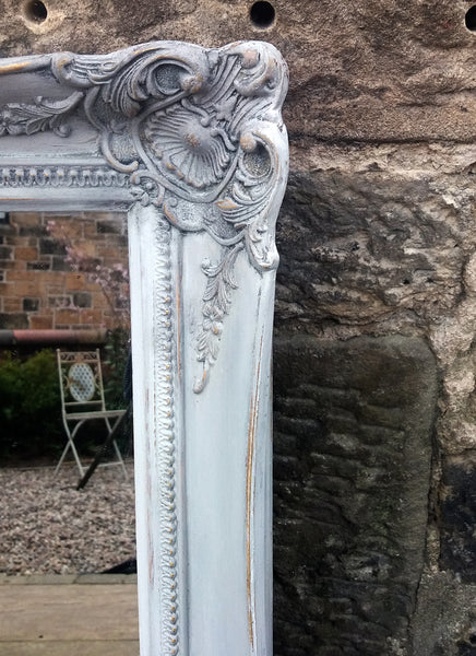 Beautiful vintage ornate mirror painted in a French grey and dark waxed with original gold showing through