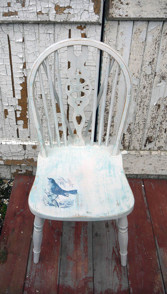 Vintage wheelback chair painted in Miss Mustard Seed Milk Paint in with blue bird toile design