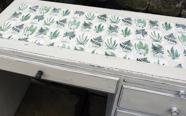 Vintage writing desk painted in chippy miss mustard seed milk paint grain sack grey layered with Bergere and a botanical fern design