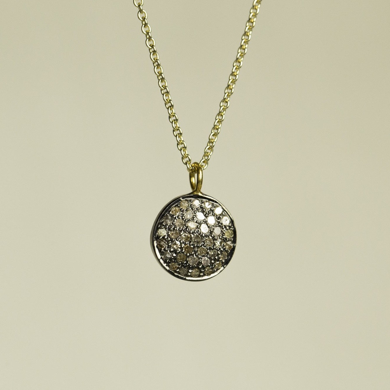 bright but not really diamond disc set in oxidised silver - for fans of the understated