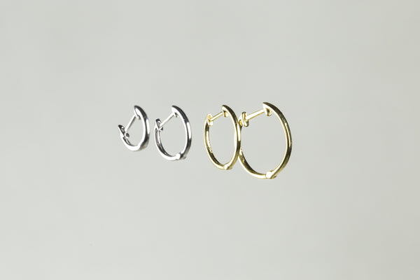 from left: 8mm white gold hoop, 10mm white gold hoop, 12mm and 14mm yellow gold hoops