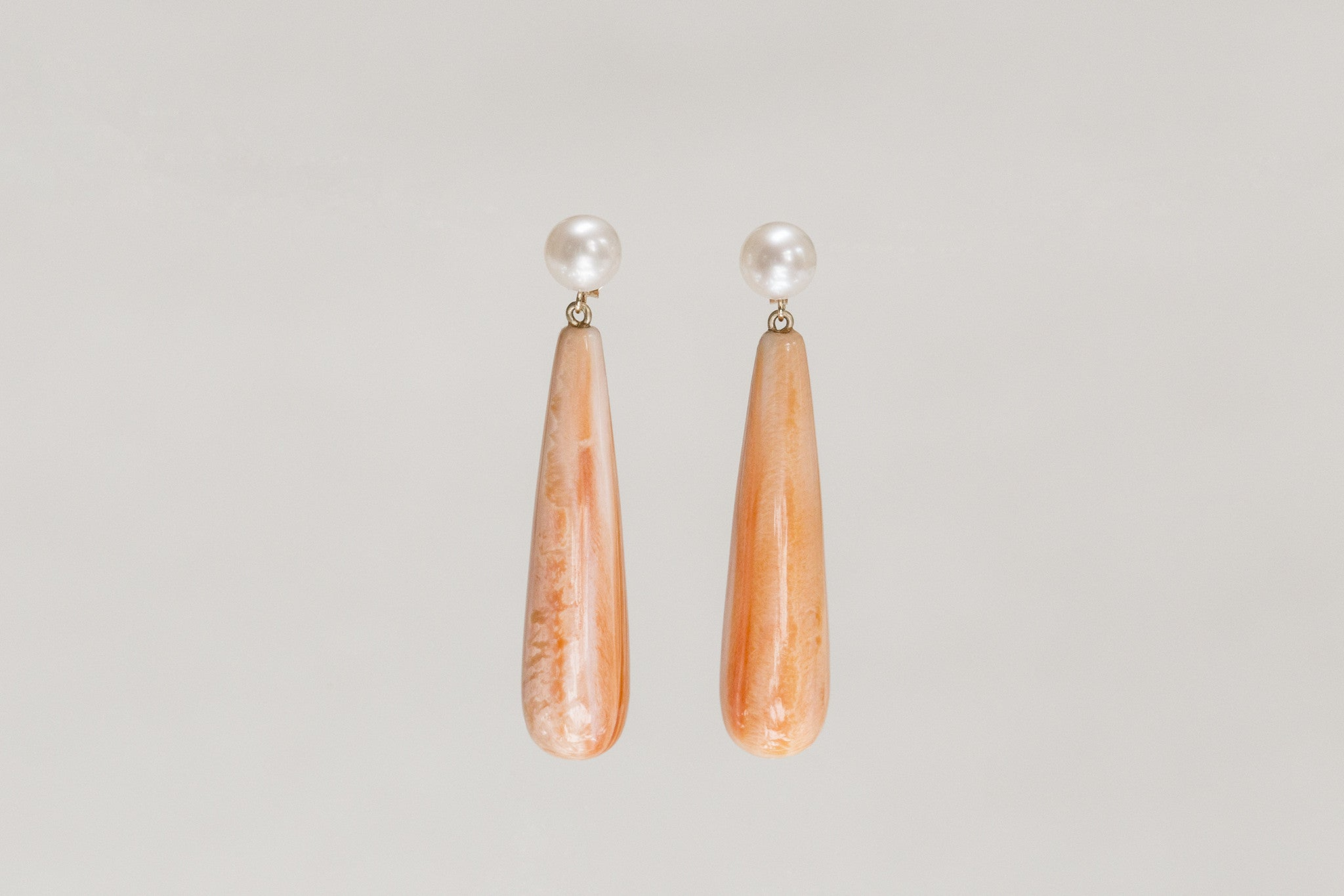 art deco inspired orange shell and freshwater pearl drop earrings